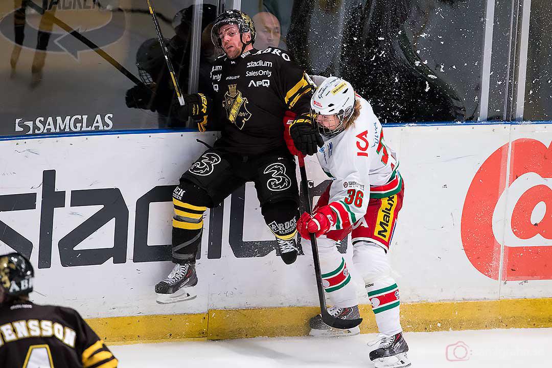 Modo Adrian Kempe trycker till AIK Oscar Steen